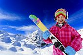 Ski, skier, winter fun - lovely girl has a fun on ski