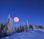 stock photo of moon stars  - Winter landscape in the mountains at night - JPG