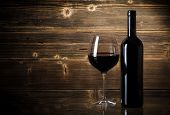 pic of merlot  - Wine bottles with glass on wooden background - JPG