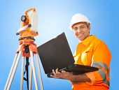 image of theodolite  - Portrait of Senior land surveyor working with theodolite at construction site - JPG