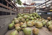 stock photo of malacca  - Fresh Coconut Fruits Delivery Truck in Chinatown Malacca Malaysia - JPG