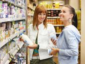 stock photo of grocery-shopping  - two friends while shopping all brandmarks removed - JPG