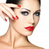 stock photo of fingernail  - Beautiful young woman with red nails and fashion makeup  - JPG