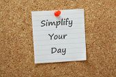picture of tasks  - The phrase Simplify Your Day typed on lined paper and pinned to a cork notice board - JPG