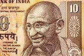 stock photo of indian currency  - Mahatma Gandhi or Mohandas Karamchand Gandhi picture on Indian Rupee Currency note - JPG
