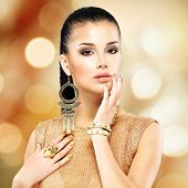image of manicure  - Portrait of the beautiful fashion woman with black makeup and golden manicure - JPG