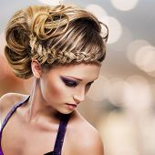 High angle portrait of beautiful woman with  hairstyle - modern fashion background