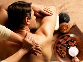 foto of backbone  - Masseur doing massage of backbone on man body in the spa salon - JPG