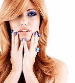 stock photo of long nails  - portrait of a beautiful woman with blue nails - JPG