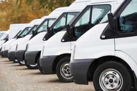 picture of wagon  - commercial delivery vans in row at parking place of transporting carrier shipping service company - JPG