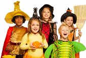 stock photo of little black dress  - Close portrait of boys and girls in Halloween costume with broom - JPG