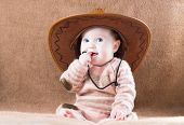 picture of baby cowboy  - Beautiful Little Girl In A Huge Cowboy Hat - JPG