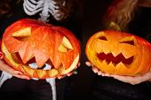 foto of antichrist  - Two carved Halloween gourds - JPG
