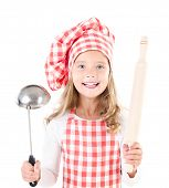 stock photo of ladle  - Smiling cute little girl in chef hat with ladle and rolling pin isolated on a white - JPG