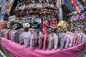 stock photo of nepali  - Nepali dhaka topi hats wool socks nepali flags and other accessories in the shop of Thamel market in Kathmandu Nepal - JPG