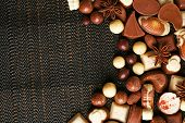 foto of kindness  - Different kinds of chocolates on dark background - JPG