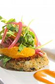 stock photo of crab-cakes  - Gourmet crab cake with grape fruit slices - JPG