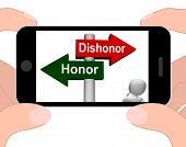 stock photo of morals  - Dishonor Honor Signpost Displaying Integrity And Morals - JPG