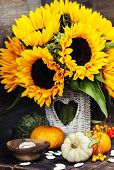 stock photo of fall decorations  - Sunflowers and Autumn decorations on wooden background - JPG
