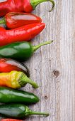 stock photo of chili peppers  - Frame of Red and Green Habanero and Jalape - JPG