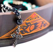 picture of rosary  - A rosary coming out of a carved box in wood - JPG