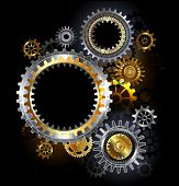 foto of outdated  - Golden and steel gears on dark background - JPG