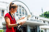 foto of bagpack  - Woman at train station sightseeing in Jakarta - JPG