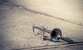 picture of trumpets  - Vintage of Trumpet placed on concrete floor - JPG