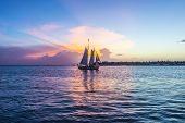 picture of florida-orange  - Sunset at Key West with sailing boat and bright sky