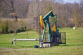 stock photo of nod  - Oil pump in green nature oilfield in Croatia - JPG