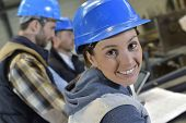 image of mechanical engineer  - Cheerful woman industrial engineer at work - JPG