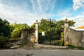 pic of wrought iron  - old wrought iron gates near the green summer house  garden in Portugal - JPG