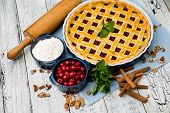 image of cherry pie  - Homemade cherry pie on wooden table. Elevated view