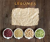 picture of legume  - Variety or legumes word Legumes and paper on a wooden table - JPG