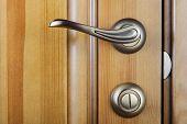 image of wooden door  - Modern style door handle on natural wooden door - JPG