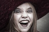 picture of evil  - woman with expression of evil and costume halloween - JPG