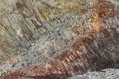 foto of rocking  - The complicated structure of volcanic rock at Cape Fiolent in Crimea - JPG