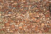 stock photo of wall-stone  - Natural stone wall made of rubble stone - JPG