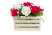 stock photo of gift basket  - Red and white rose in a wooden basket with beautiful ribbon gift for valentine  - JPG