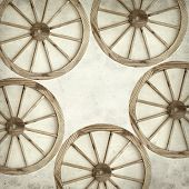 pic of wagon wheel  - textured old paper background with old wagon wheel - JPG