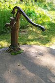 picture of water well  - old handy water well pump in the garden - JPG