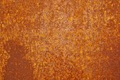 foto of rusty-spotted  - rusty and dirty metallic brown surface with spots - JPG