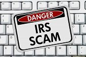 stock photo of irs  - IRS Scam Danger Sign A red and white sign with the words IRS Scam on a keyboard - JPG
