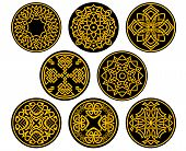 foto of celtic  - Decorative round assorted intricate patterns in yellow in medieval celtic style - JPG
