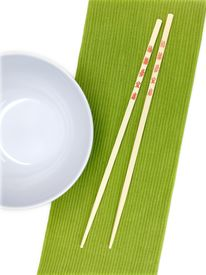 picture of kitchen utensils  - Chop sticks on a noodle bowl on a kitchen bench - JPG