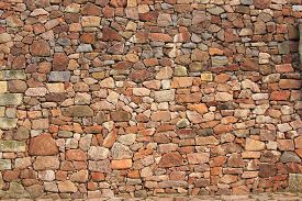stock photo of mortar-joint  - Natural stone wall made of rubble stone - JPG