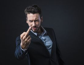 stock photo of middle finger  - Cool handsome angry man showing off middle fingers - JPG