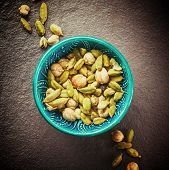 picture of cardamom  - Various Cardamom Spices in Authentic Turkish Crockery - JPG