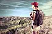 foto of mountain-climber  - Female Climber Looking At Beautiful Mountain Landscape - JPG