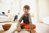 Постер, плакат: Cute Little Boy Drawing And Coloring In Living Room